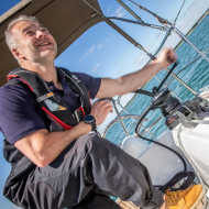 sailor trimming the main sail of sunsail 41.0